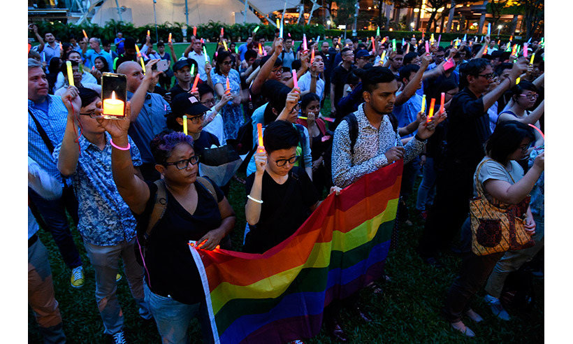 Hundreds mourned the tragedy in Singapore's Hong Lim Park. 