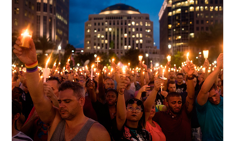 Thousands participated in a candlelight vigil at the Dr. Phillips Center for the Performing Arts in Orlando. 