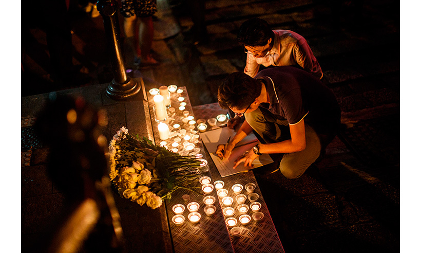Mourners signed a book of remembrance in Hong Kong. <p>Photo: © Anthony Wallace/AFP/Getty Images</p>