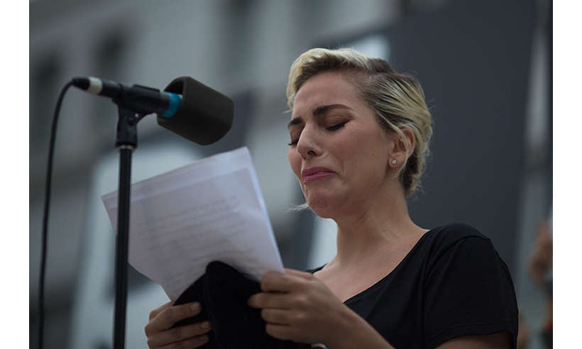 Lady Gaga broke down in tears while delivering an emotional speech during a vigil in Los Angeles. 