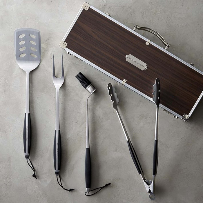 "<strong>Williams-Sonoma BBQ Tools Set in Wood Box</strong>, $125, <a href=""http://williams-sonoma.com"" target=""_blank"">williams-sonoma.com</a>"
