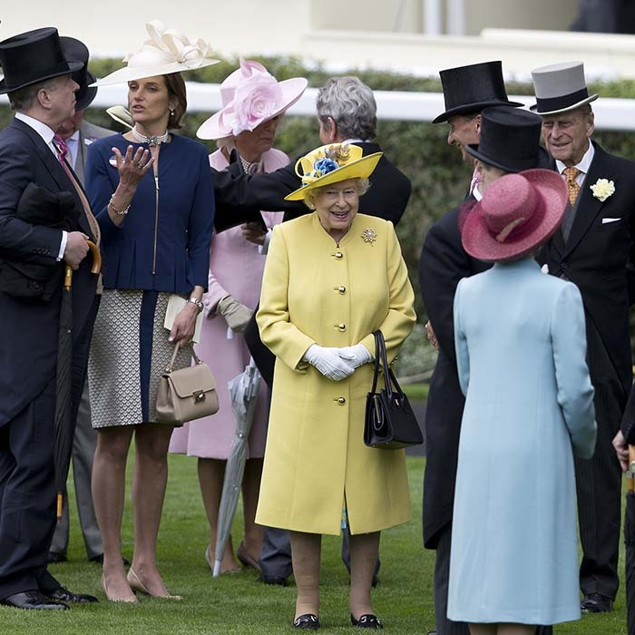 With rain threatening to wash out festivities, the Queen added a dose of sunshine to the opening day of Ascot.