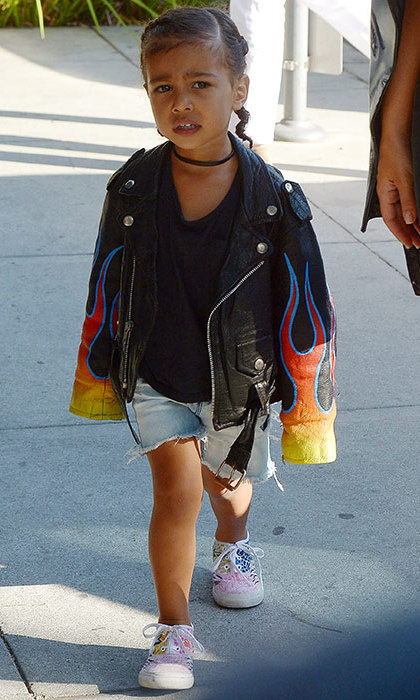 North rocked 90s grunge with this flame-patterned leather jacket and cutoff denim shorts paired with an on-trend choker.
