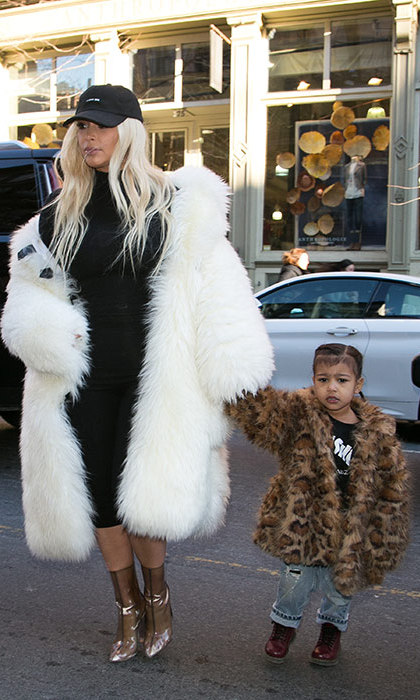 Like mother like daughter! Kim and North both stepped out in fur coats in February 2016, with the stylish tot adding ripped jeans and a printed tee.