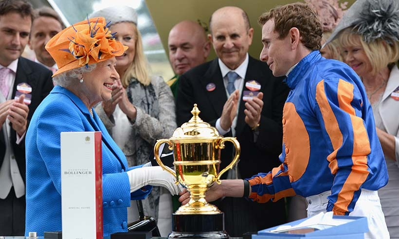 Her Majesty presented the Gold Cup trophy to jockey Ryan Moore, who raced to victory atop the Irish horse Order of St. George. 