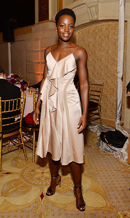 Lupita Nyong'o stuns in a delicate ballet pink Boss Fall 2016 silk charmeuse dress at the 2016 Tony Awards after party.