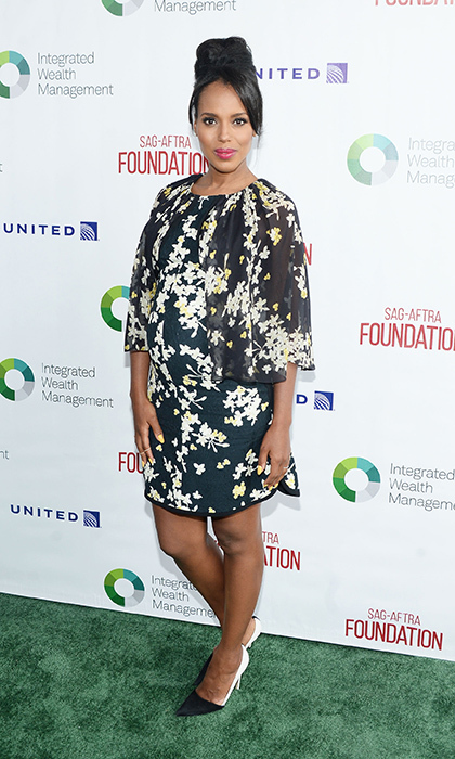 Kerry Washington is the master of maternity style in a floral print Giambattista Valli dress with a ruffled chiffon cape and monochromatic colour-block SJP by Sarah Jessica Parker Rampling pumps at the L.A. Golf Classic Fundraiser. 