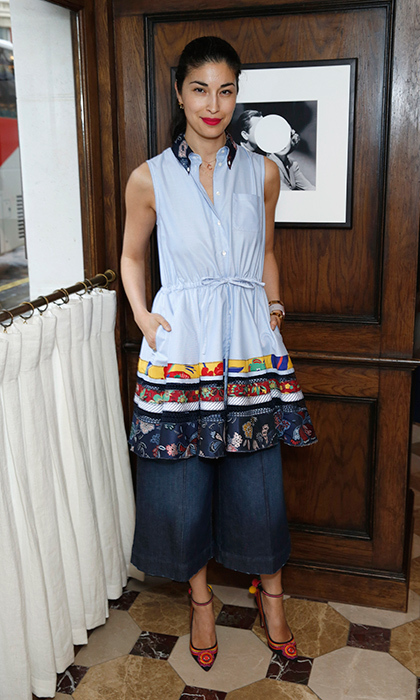 Fashion girl Caroline Issa is seaside chic in a ruffled Hilfiger Collection blouse, denim culottes and colourful Dolce & Gabbana heels at the Tommy Hilfiger dinner in London. 