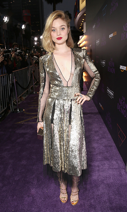 Stylish newcomer Bella Heathcote shines in gilded Alexander McQueen with cut-out and sheer detailing and Giuseppe Zanotti metallic strappy sandals at the premiere of <em>The Neon Demon</em>.