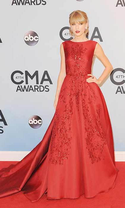 Wowing on the 2013 CMA Awards red carpet in a glamorous red gown.