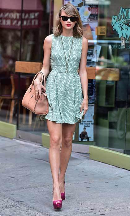 The country singer perfected summer chic on a day out in New York with a stylish mint dress which she paired with bright heels and a nude bag.