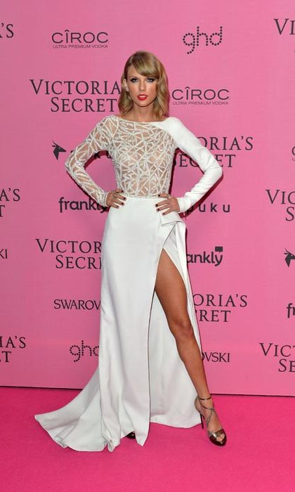 Taking the Victoria's Secret pink carpet by storm in this white and silver gown.