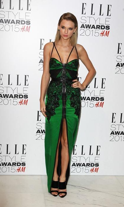 Slicking back her blonde locks to let her gorgeous green gown take centre stage.