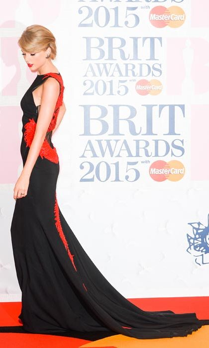 Wowing in a flame-hued floor-sweeping gown at the Brit awards.