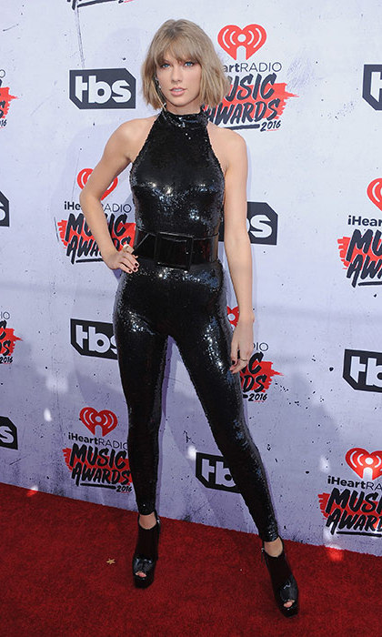 The 26-year-old's style evolution continued at the iHeartRadio Awards, where Taylor wowed in a figure-hugging sequin jumpsuit.