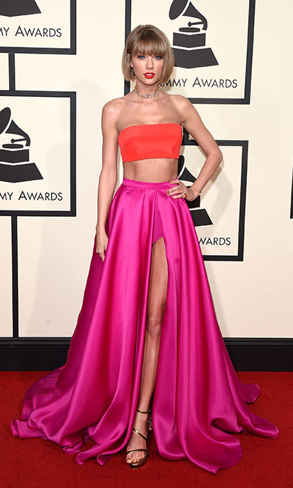 Showing off her killer figure and a new 'do in a bold colour block bandeau top and skirt at the Grammys.