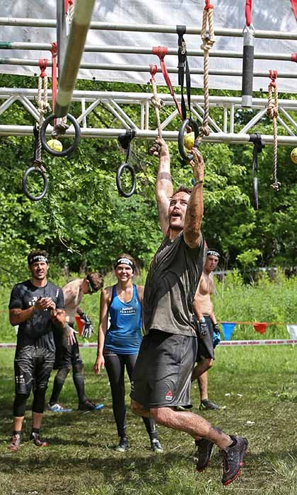 Canadian actor Taylor Kitsch showed off his strength during the Spartan Super Race in Richmond, Illinois. The star was joined by his <i>Friday Night Lights</i> co-stars Zach Gilford, Aimee Teegarden and Minka Kelly. 