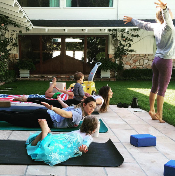 "Drew Barrymore practices with her daughter Olive. ""Princess Elsa came to our mother daughter yoga class,"" she captioned the cute Instagram snap.