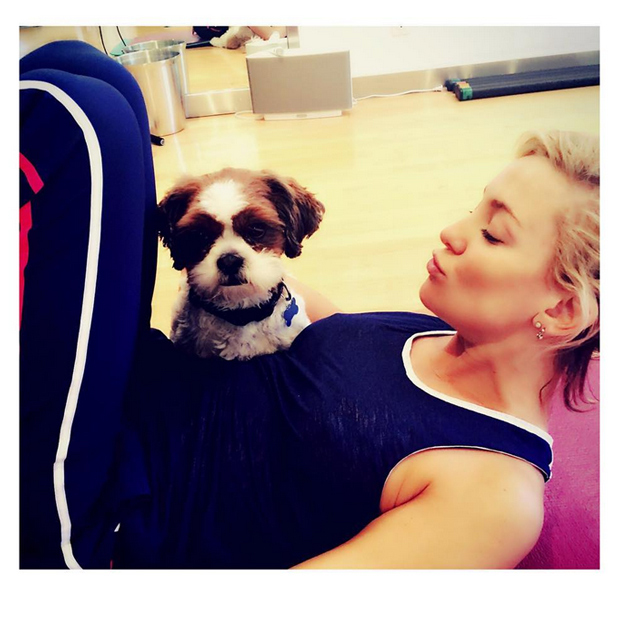Kate Hudson keeps her yoga practice lighthearted, cozying up on the mat with her cute pooch, Wally Hudson. And perhaps working on their downward dog pose together?