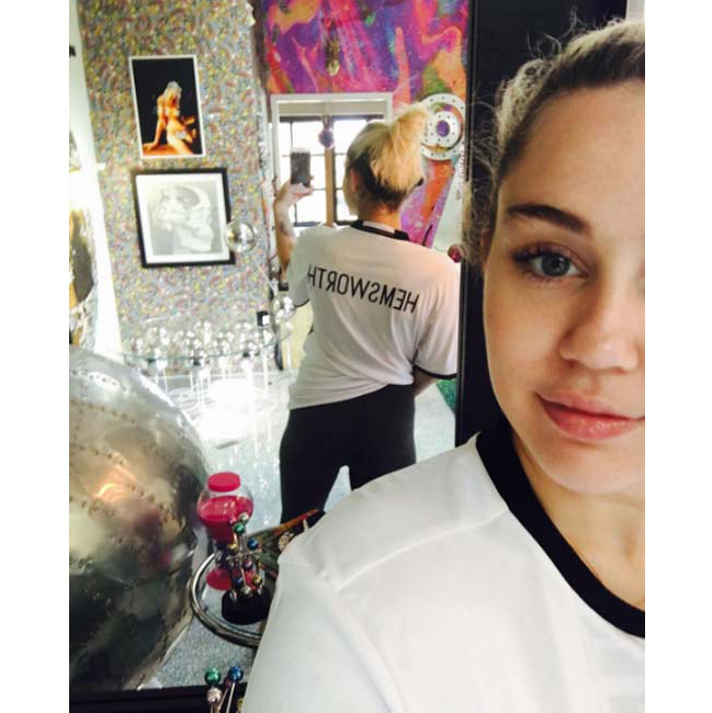 <p>Miley Cyrus appeared to confirm her relationship with on/off boyfriend Liam Hemsworth on Sunday by posting a snap of herself sporting a tshirt emblazoned with 'HEMSWORTH'.</p><p>And it's not the first time celebrities have used their clothes to make a statement about their relationship - click through to see more... </p>