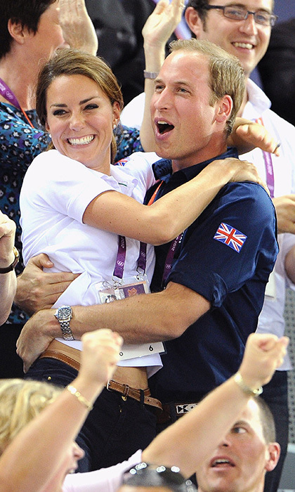 In a rare show of public affection, William and Kate celebrated Team GB's cycling win at the London Olympics in 2012. The couple were captured in the cutest embrace, and were also game enough to take part in the Mexican Wave.
