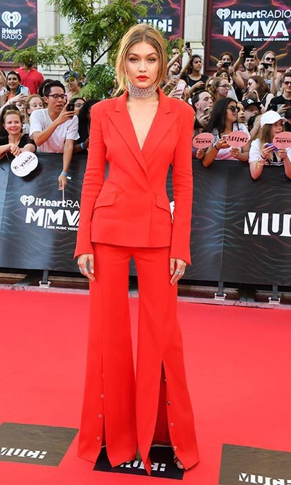 Gigi wowed on the red carpet in a red Mugler suit.
