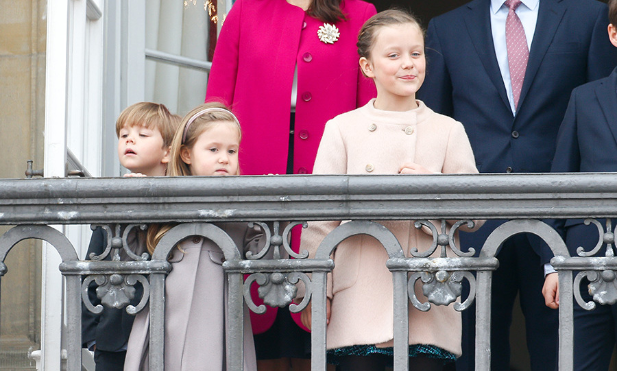 The princess with her family on the palace balcony.