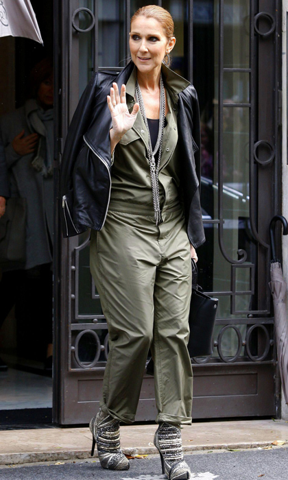 The mother of three looked casual and cool in an army green jumpsuit and leather jacket.