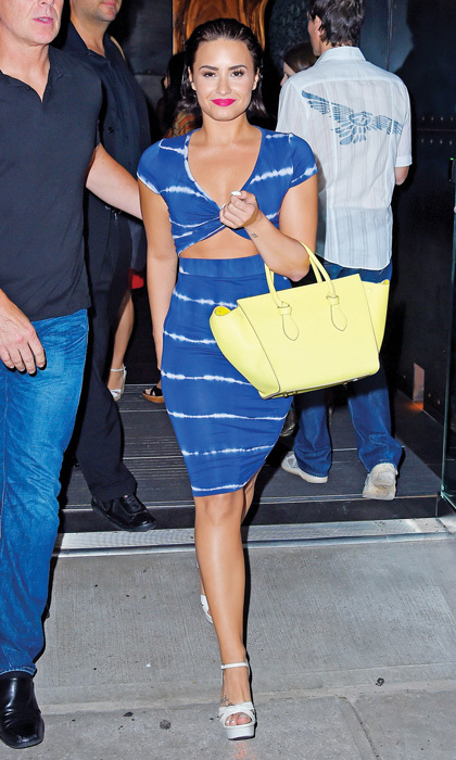 Mix bold pieces – like Demi Lovato's tie-dye dress, banana-yellow Céline bag and hot-pink lip – for a fresh, youthful hit of colour.