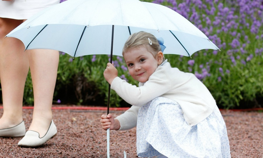 July 2015: Peek-a-Boo, we see you! Princess Estelle hid under her umbrella at her mom, Crown Princess Victoria of Sweden's 38th birthday celebrations.