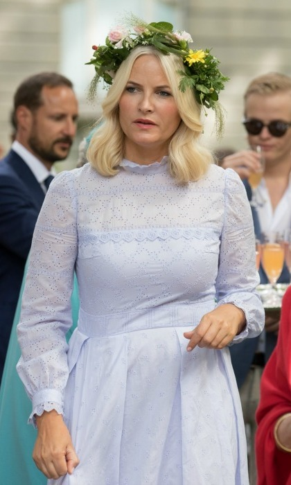 Princess Mette-Marit wore a pretty broderie anglaise and floral garland for a garden party on Thursday.