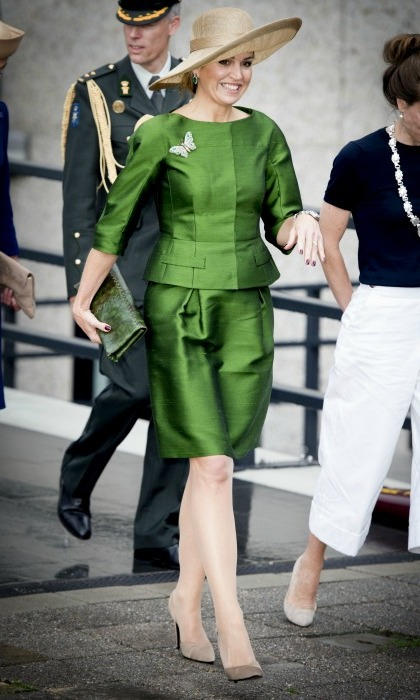 Queen Maxima turned heads in a vibrant green skirt suit at a conference on Saturday.