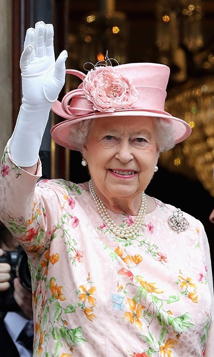 Her Majesty is resplendent in pink florals during a visit to Liverpool.
