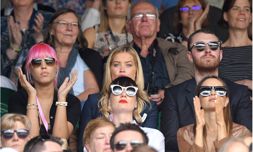 Sam Smith (R) watched all the action alongside model Amber Le Bon (L) and Irish TV personality Laura Whitmore. 