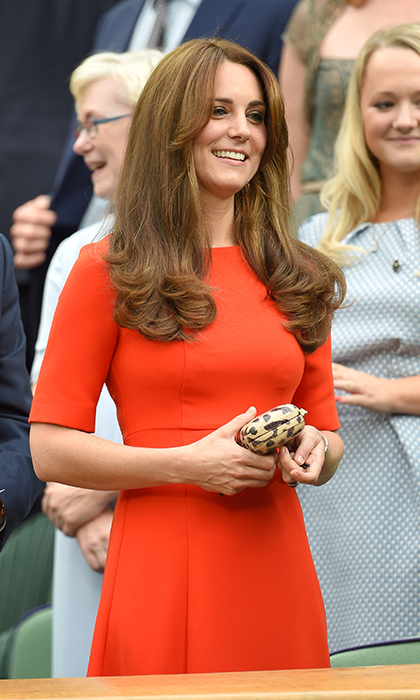 Kate returned in Wimbledon in 2015 in a striking cardinal red LK Bennett dress paired with a Diane von Furstenberg leopard print clutch. 