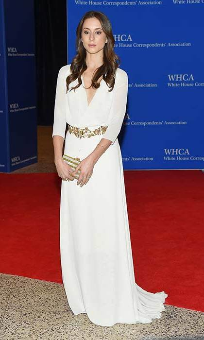 The actress looks elegant in a Grecian-style white gown and filigree detail belt.