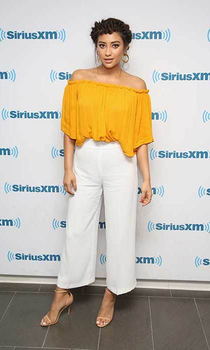 Shay ticks all the trend boxes with a yellow Bardot top, culottes and braided updo.