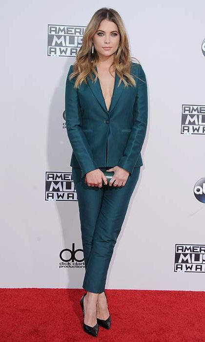 A jewel-toned suit creates an unexpected red carpet look for the <em>Pretty Little Liars</em> star.