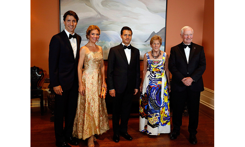 Sophie glistened in a hi-low brocade ball gown by THEIA at a state dinner celebrating Mexican President Enrique Peña Nieto's visit to Ottawa. The style star accessorized the golden showstopper with Alan Anderson earrings and a gold-plated Garema Mia clutch.  