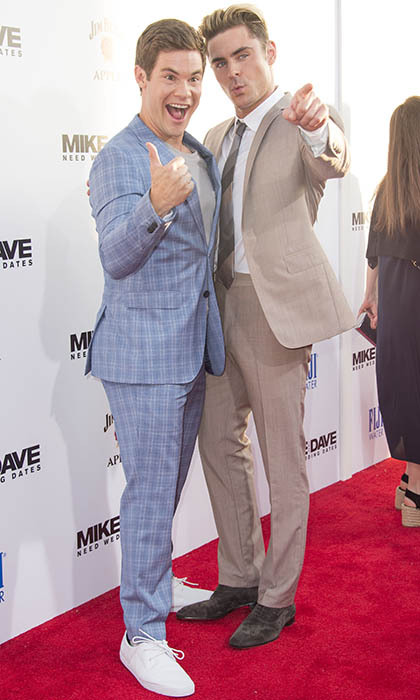 It's hard to believe that Adam Devine and Zac Efron would have any problems finding dates to a wedding. Here, the talented duo strike a pose at their film's premiere in Los Angeles. 