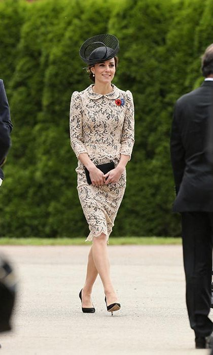 The Duchess of Cambridge looked elegant in a bespoke lace peplum dress on Friday.