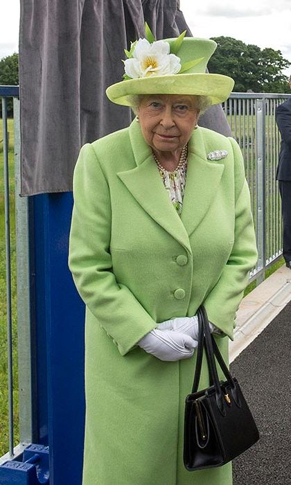 The Monarch wore a spring green coat and hat for a visit to Northern Ireland.