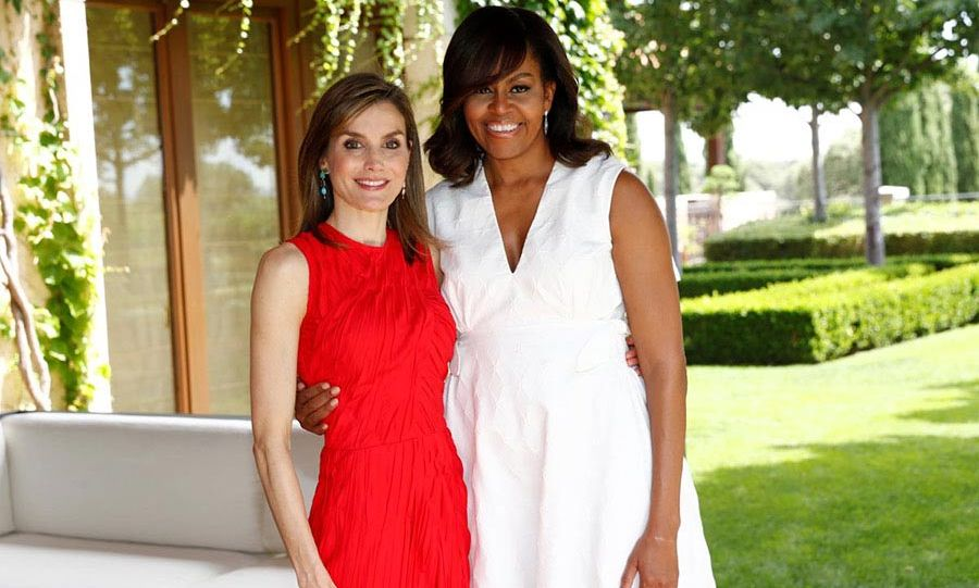Queen Letizia looked radiant in a red dress for a visit from Michelle Obama.