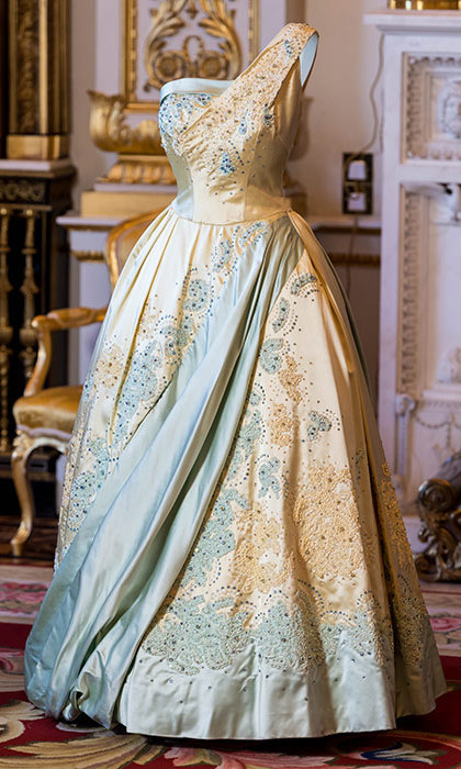 A general view of a pale blue and gold evening dress by Sir Norman Hartnell, worn by the Queen on a state visit to The Netherlands in 1958.