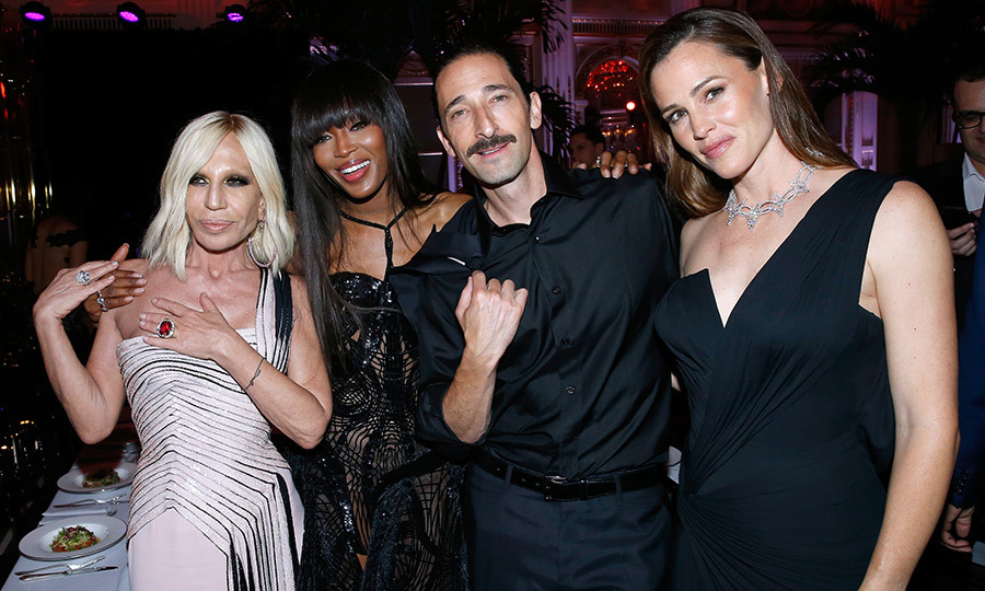 The amFAR Paris dinner drew a host of famous faces, including Donatella Versace, supermodel Naomi Campbell, Adrien Brody and Jennifer Garner.