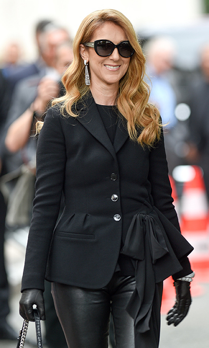 Celine Dion was glam in dark shades, leather trousers, Butani baubles and a peplum jacket to attend the Christian Dior presentation.