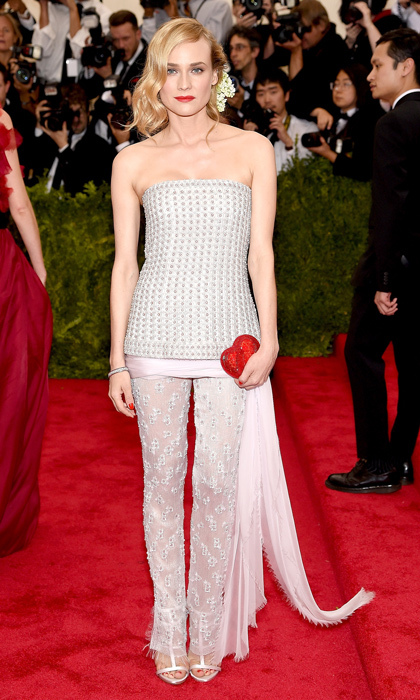 Diane was pretty in pink at the Met Gala with sheer embellished trousers and a heart-shaped red clutch.