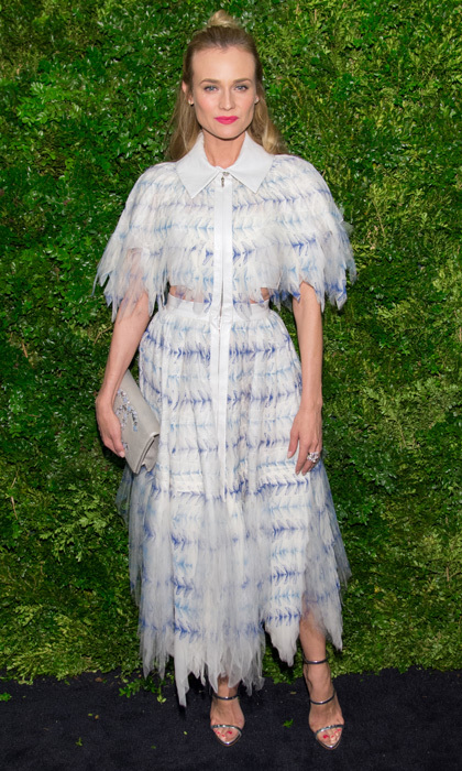 The shredded detail of this dress and half-knot hairstyle play to Diane's sartorial edge.