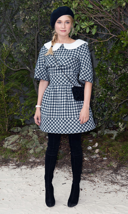 Diane embodied sophisticated collegiate chic with a plaid dress and black tights topped off with her black beret.