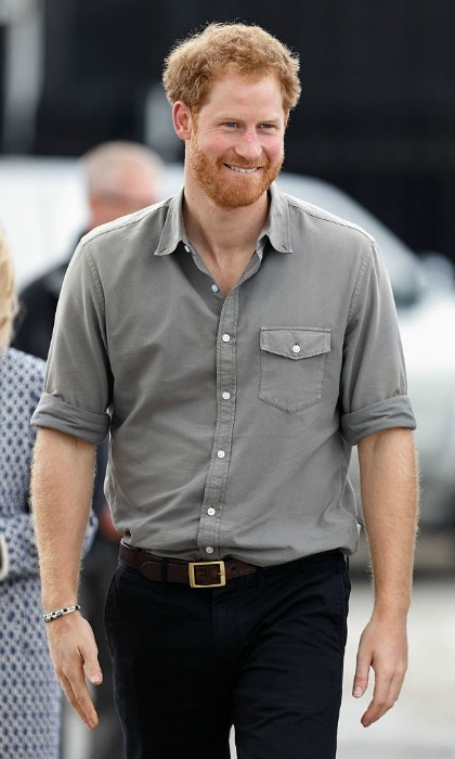 During the July 5 outing, Prince Harry was serenaded and propositioned with a kiss.